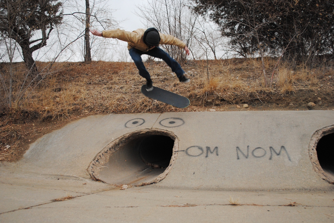 "kickflip over the ""om nom"" spot"
